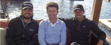 Shane O'Donaghue with Jason Day (left) and Charl Schwartzel (right) in Abu Dhabi