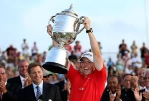 Rory McIlroy proudly holds the Rodman Wanamaker Trophy after winning the PGA Championship – Credit: Getty