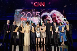 NEW YORK, NY - NOVEMBER 17: Host Anderson Cooper (L) poses with 2015 CNN Heros at CNN Heroes 2015 - Show at American Museum of Natural History on November 17, 2015 in New York City. 25619_022 (Photo by Kevin Mazur/Getty Images for CNN)