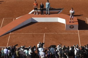 Switzerland's Stanislas Wawrinka (R) celebrates with the trophy following his victory over Serbia's Novak Djokovic at the end of their men's final match of the Roland Garros 2015 French Tennis Open in Paris on June 7, 2015. AFP PHOTO / MIGUEL MEDINA (Photo credit should read MIGUEL MEDINA/AFP/Getty Images)