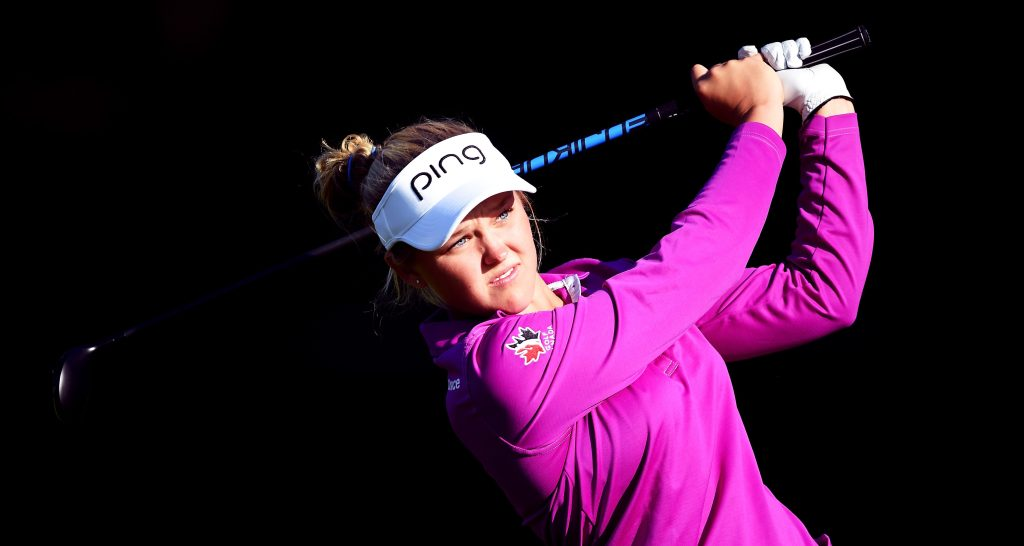 EVIAN-LES-BAINS, FRANCE - SEPTEMBER 08: Brooke M Henderson of Canada plays a shot during practice prior to the start of the Evian Championship Golf on September 8, 2015 in Evian-les-Bains, France. (Photo by Stuart Franklin/Getty Images)